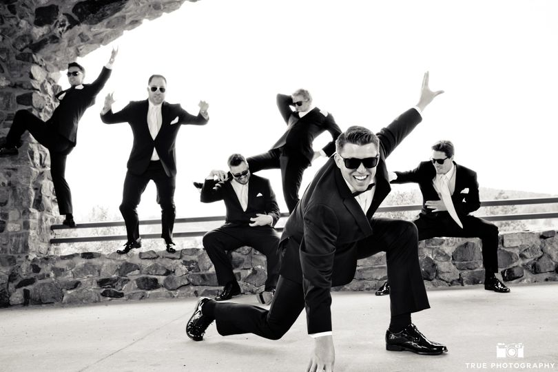 Groomsmen having fun out front