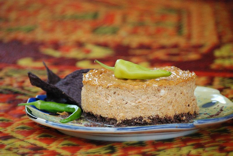 Chipotle cheese torte with blue corn chip crust.