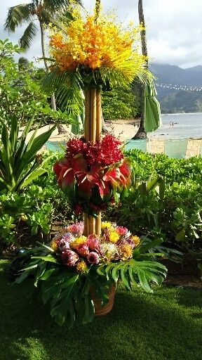 6' TALL BAMBOO STRUCTURE- ASSORTED PROTEAS, LARGE OBAKE ANTHURIUMS, YELLOW MAKARA & ONCICIDUM ORCHID...