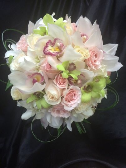 CLUTCH BOUQUET- WHITE CYMBIDIUMS, GREEN DENDROBIUM, LIGHT PINK & WHITE ROSES