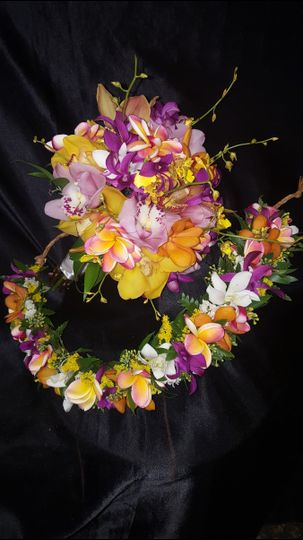 ORCHID CLUTCH, CYMBIDIUMS, DENDROBIUMS & ONCIDIUMS  WITH MATCHING HAKU HEAD LEI