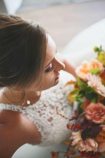 Lace straps against floral arrangement