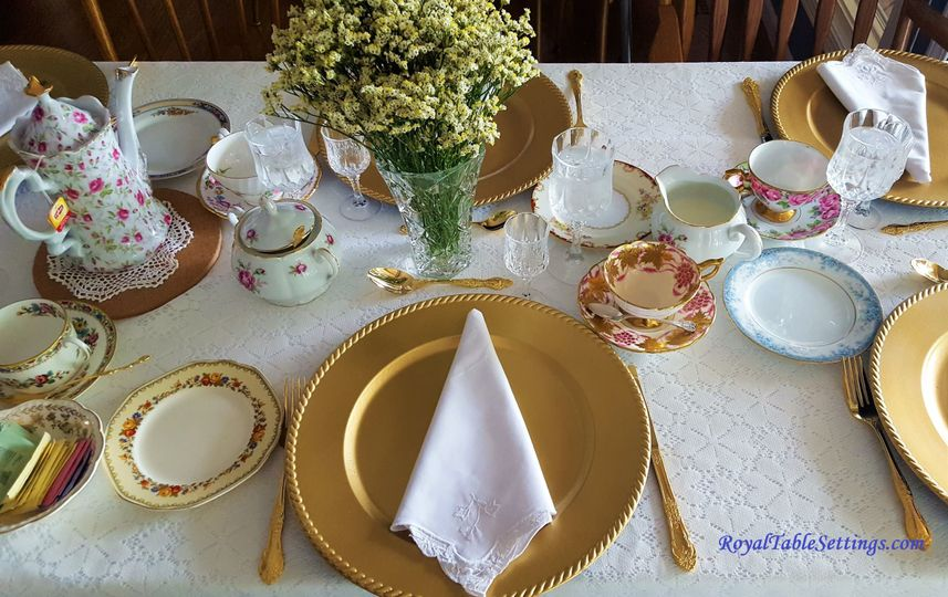 A vintage tea party with crystal stemware, gold chargers and vintage napkins set the mood for a...