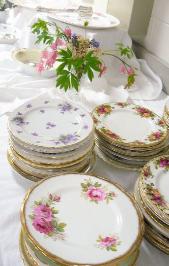 Vintage Salad plates, bowls and platters ready for a buffet luncheon.