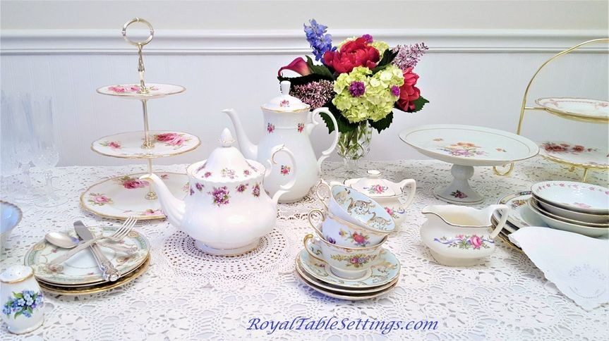 Three tiered cake stands, sugar and creamer bowls, and crystal vases complete any vintage look for...