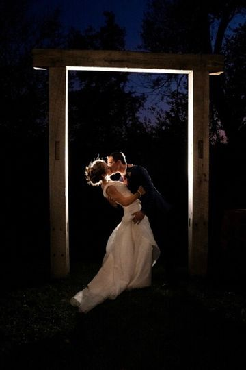 Bride and groom barn beam arch