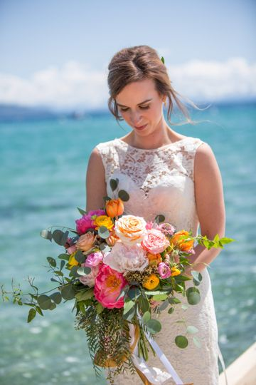 Bride holding her bouquet by the sea