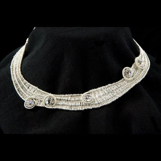 Woven choker in fine silver and sterling silver accented with faceted cubic zirconia.