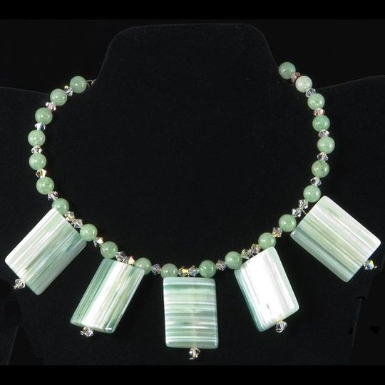 Necklace of aventurine and dramatic squares of striped agate, accented with Swarovski crystals.