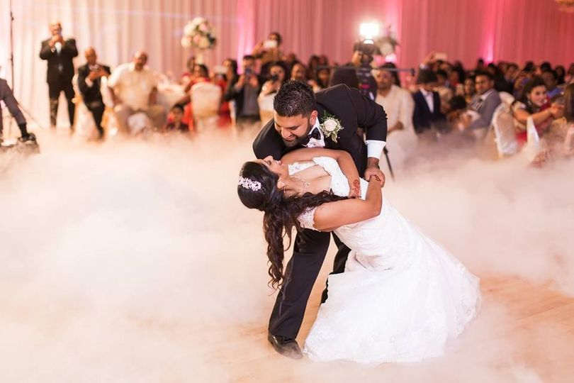 Newly weds dancing on clouds