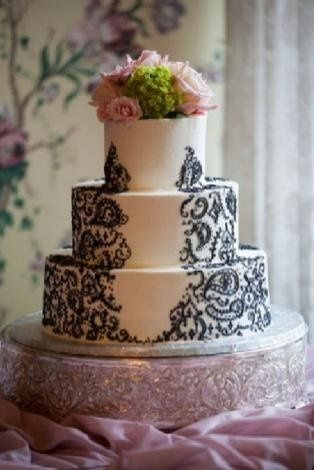 Cake topper of pink roses and hydrangeas.