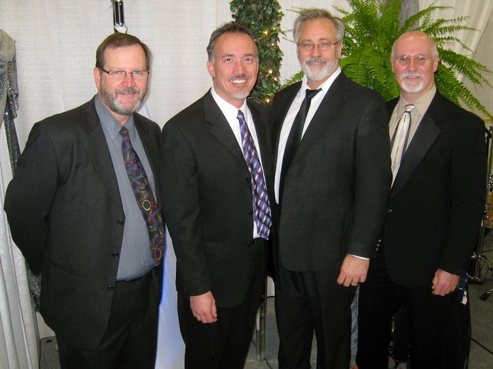 Photo of the UpFront quartet that features Steve on Sax, Chris on Keyboards and vocals, Robert on...