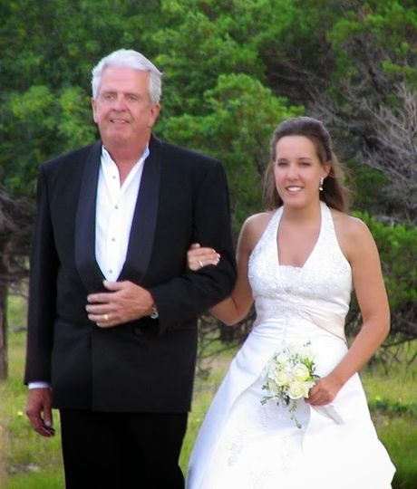 Father of the Bride escorting his beautiful daughter down this picturesque garden aisle
