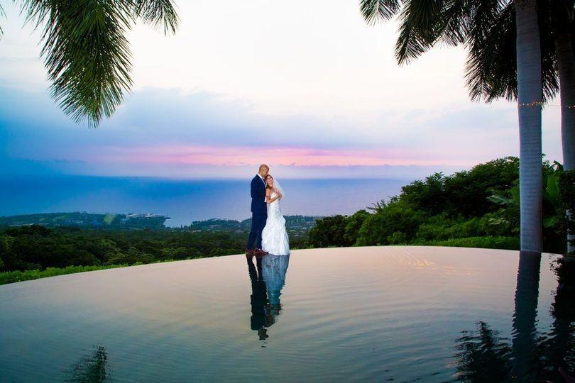 Bride & groom at the infinity pool