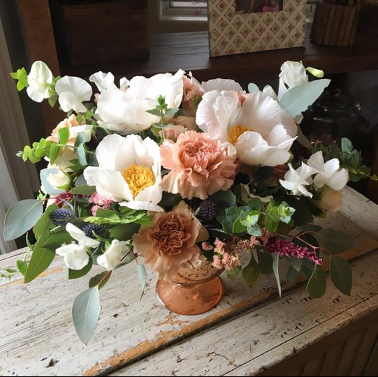 Table centerpiece with peonies