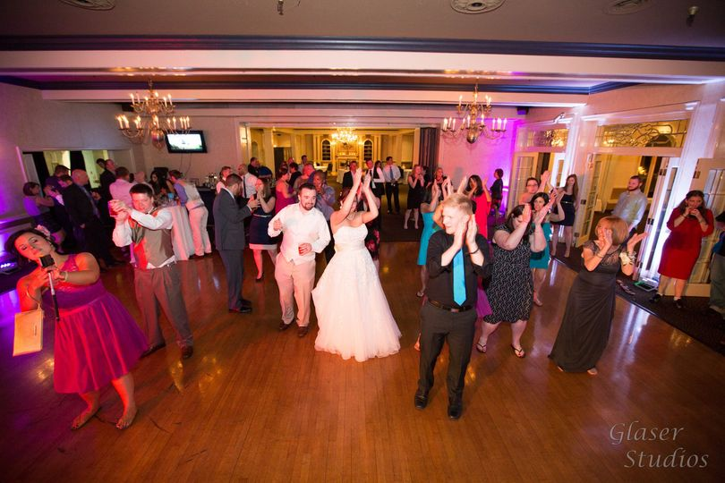 Newlyweds and their guests dancing