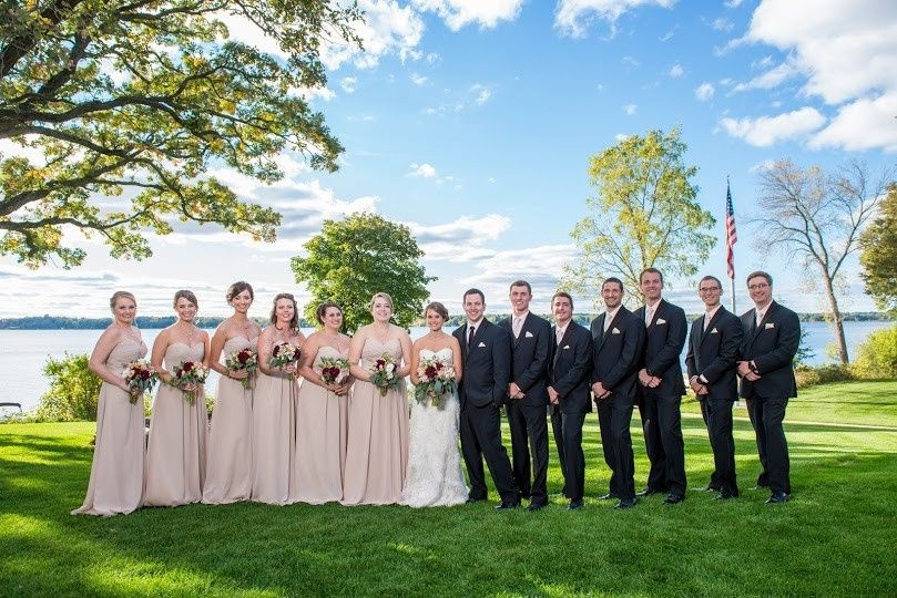 Bride, groom, and their guests by the sea