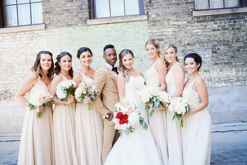 Newlyweds with the bridesmaids