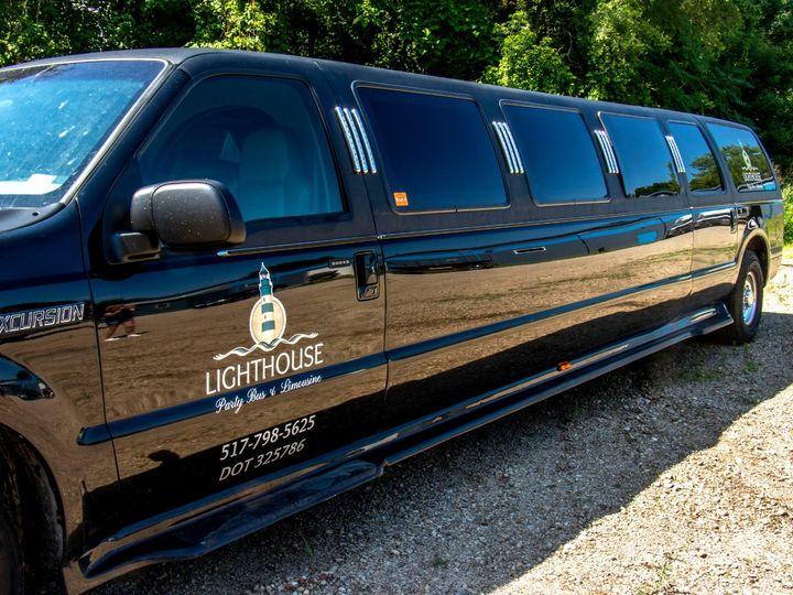 Tmx Rock Harbor 14 Passenger Stretch Suv Limo Driver Side Stretch View 51 1067147 1563927297 East Lansing, MI wedding transportation