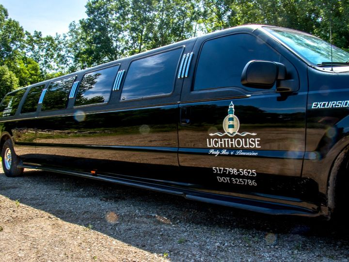 Tmx Rock Harbor 14 Passenger Stretch Suv Limo Passenger Side Stretch View 51 1067147 1563927319 East Lansing, MI wedding transportation