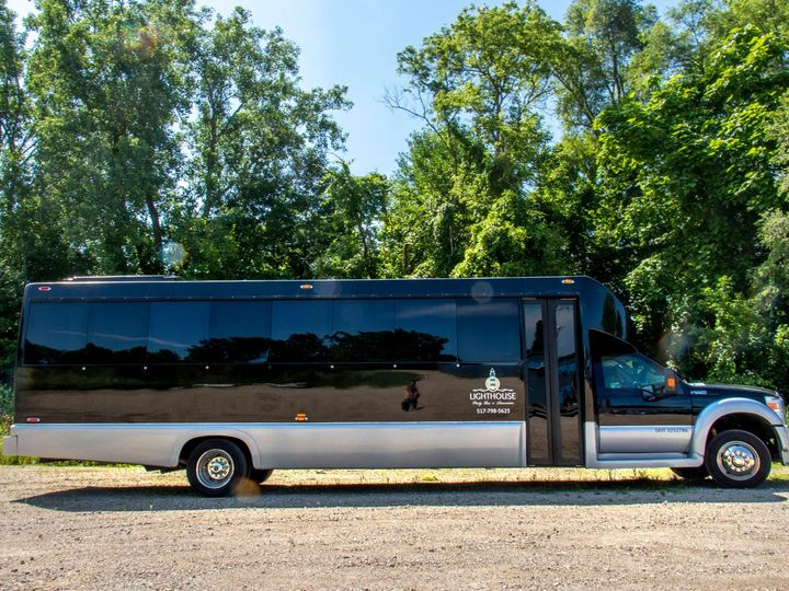 Tmx Spectacle Reef 30 Passenger Party Bus Full View Of Passenger Side 51 1067147 1563927330 East Lansing, MI wedding transportation