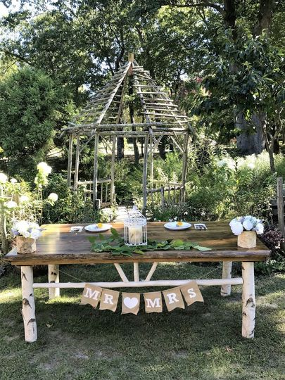 Host table with white birch legs