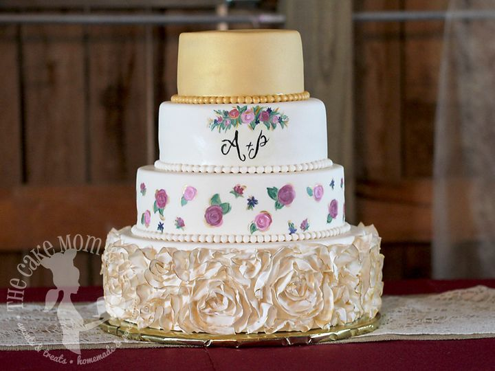 Gilded ruffled rosettes and handpainted floral monogram wedding cake. Featured on The Knot.