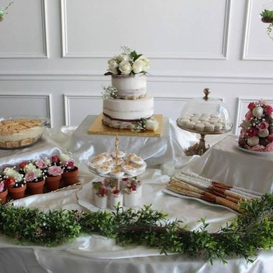 Naked cake with dessert table