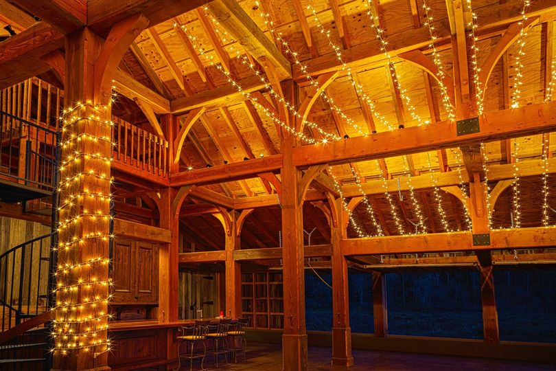 The barn was purpose-built for events and has never held livestock.  Giant beams and polished...