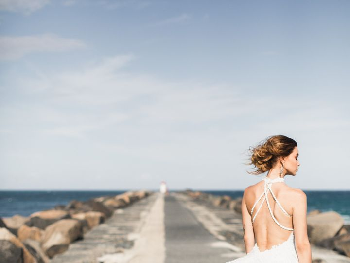 Tmx Woman Wearing White Backless Dress Standing On Concrete 2122359 51 1951247 158467156814374 Charlevoix, MI wedding planner