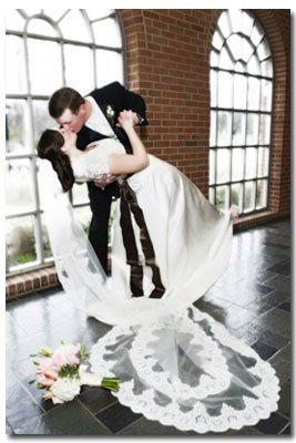 Groom Dips and Kisses Bride