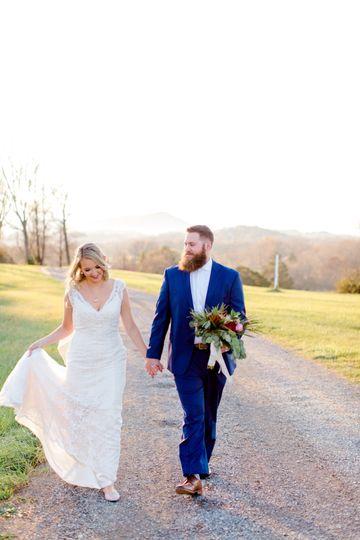 Gentry wedding - bride and groom walking on road