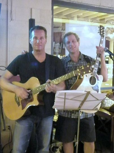 This acoustic duo is great for ceremony music or a quieter reception. They play a wide variety of...