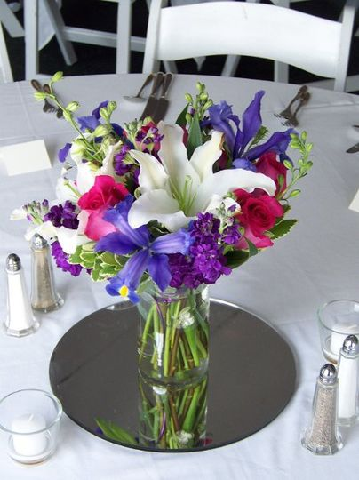 A colorful centerpiece created in a clear glass centerpiece. This was part of a beautiful tent...
