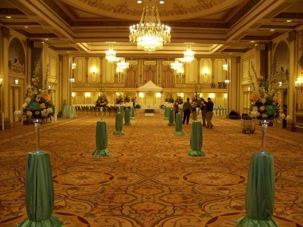 Wedding aisle set with centerpieces at the Palmer House Hilton in Chicago, IL. The room was leater...