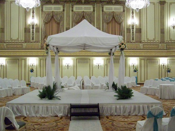 A chuppah set for a wedding at the Palmer House Hilton in Chicago, IL. Flowing organza material...