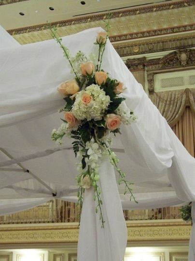 A close-up of the chuppas decor at the Palmer House Hilton.  White dendrobium orchids, peach...