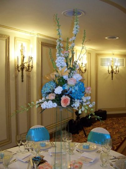 Centerpiece, now set in place on the guest table at the Palmer House Hilton.  Each arrangement was...