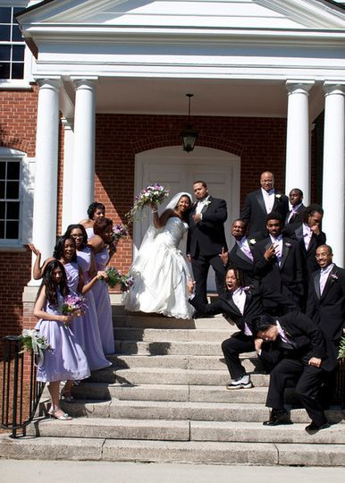 The couple with their groomsmen and bridesmaids,