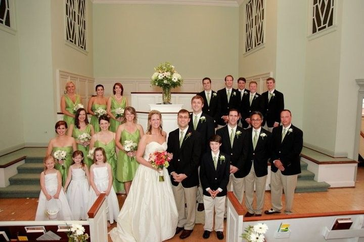 The couple with their groomsmen, bridesmaids, and kids at the wedding