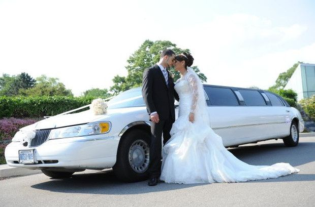 bride and groom infront of limo
