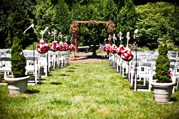Ceremony set up at a traditional Jewish Wedding set in a garden at a historical inne in Malvern, Pa