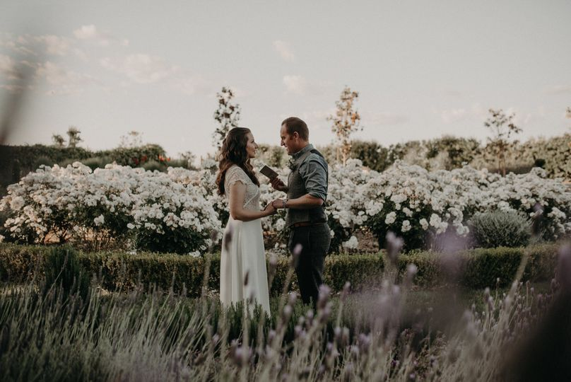 Couple's photo with the white flower backdrop
