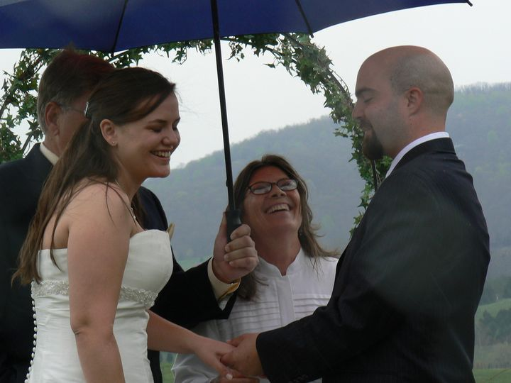 Shielding the bride and groom from the weather