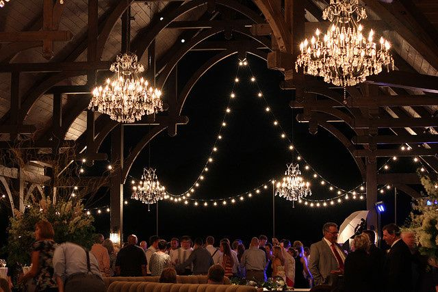 Our gorgeous Signature Chandeliers with festoons of G50 bulb string lighting for Dale Earnhardt...