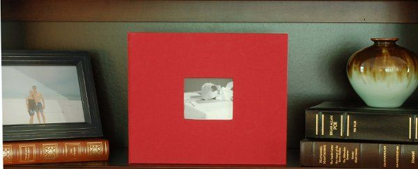 red guest book on shelf