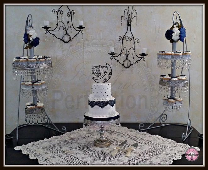 Vintage two-tiered white and navy with edible lace and custom built chandelier cupcake stands.