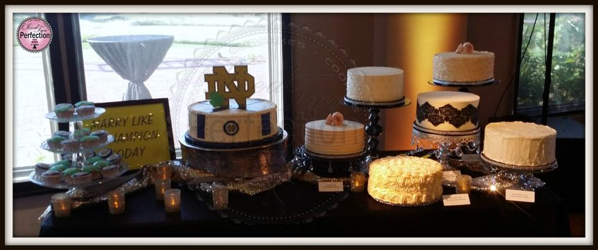 Full view of the wedding dessert table.
