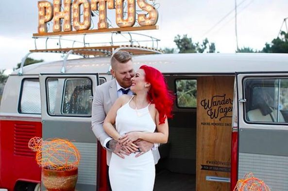 Newlyweds and minivan photo booth