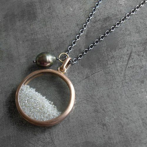 Antique rose gold locket filled with 5 carats of rough diamonds, with a Tahitian pearl charm on a...